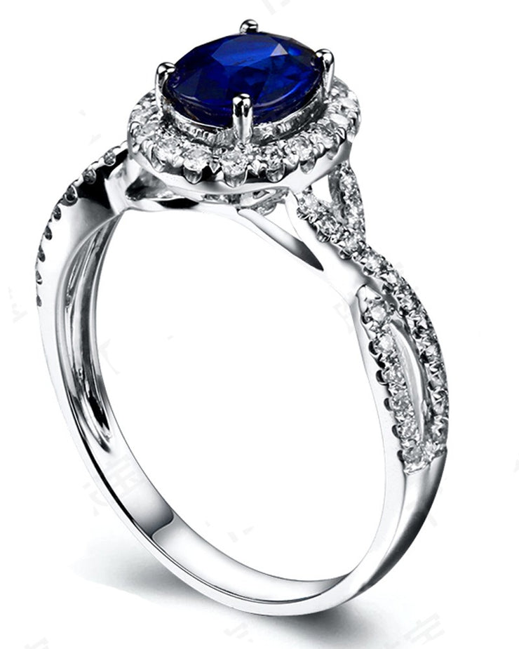 2 Carat oval cut Blue Sapphire and Moissanite Halo Engagement Ring in White Gold