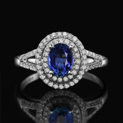 2 Carat oval cut Blue Sapphire and Moissanite Diamond Halo Engagement Ring in White Gold