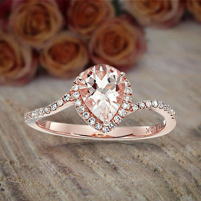 1.25 Carat Peach Pink Morganite (pear cut Morganite) and Diamond Engagement Ring