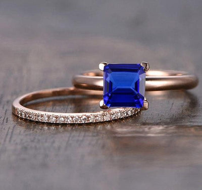1.25 carat Blue Sapphire and Moissanite Diamond Halo Bridal Set in 10k Rose Gold