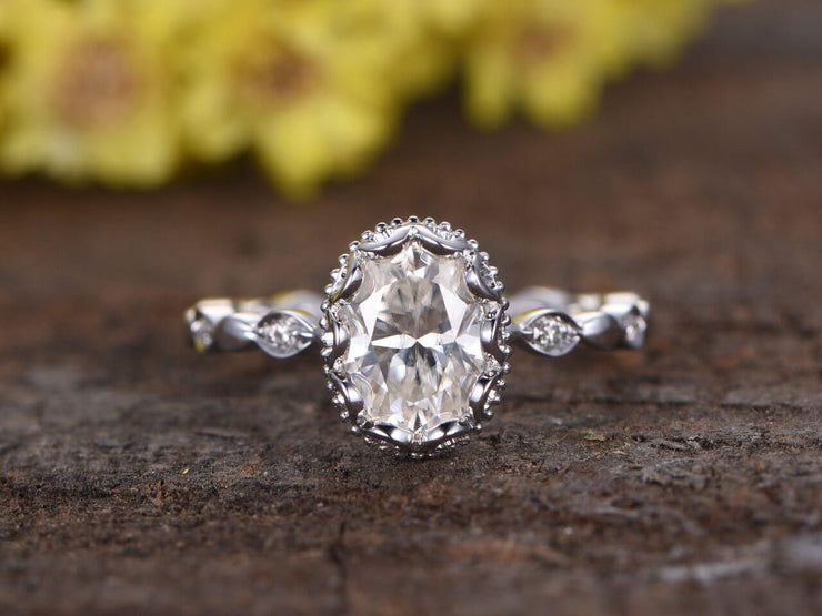 Oval cut 1.25 Ct Halo Moissanite and Diamond Engagement Ring in 10k White Gold