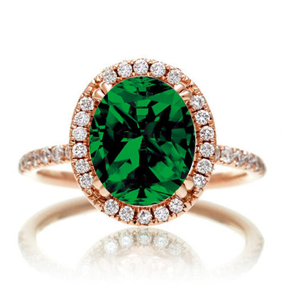 1.5 Carat Oval Classic Emerald and Moissanite Diamond halo ring on 10k Rose Gold