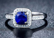 1.50 Carat Blue Sapphire and Moissanite Diamond Halo Engagement Ring for Women in White Gold