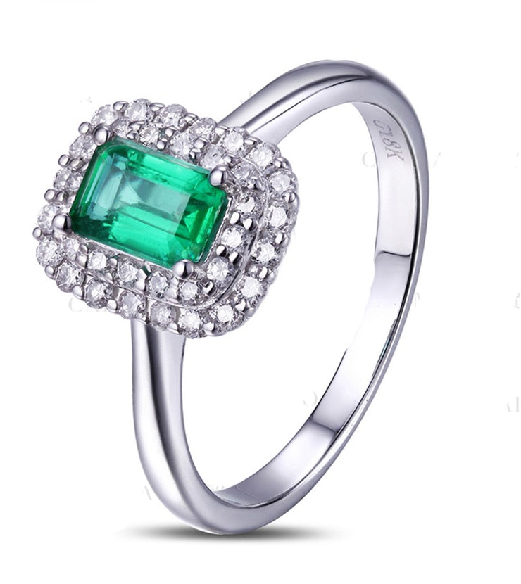 1.50 Carat Emerald and Moissanite Diamond double Halo Engagement Ring in White Gold