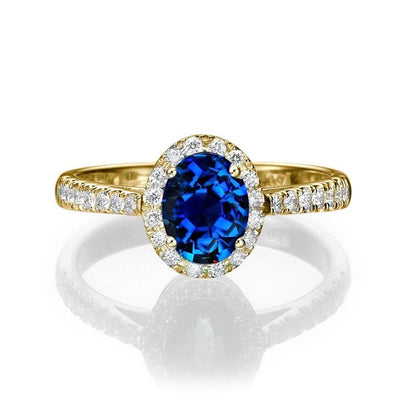 1.50 carat Oval Cut Sapphire and Moissanite Diamond Halo Engagement Ring in 10k Yellow Gold