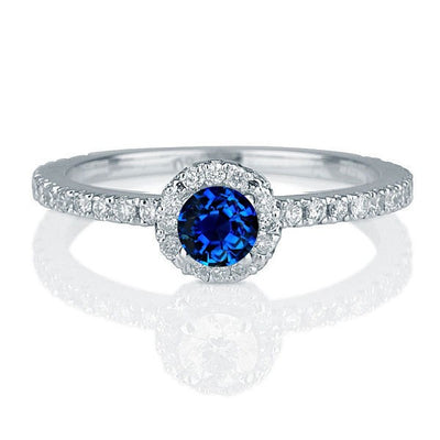 1.50 carat Round Cut Sapphire and Moissanite Diamond Halo Engagement Ring in 10k White Gold