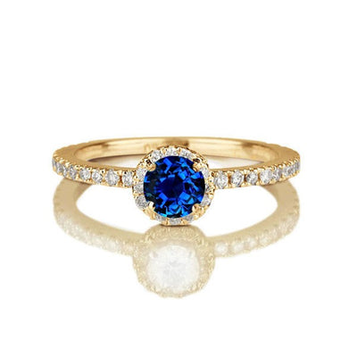 1.50 carat Round Cut Sapphire and Moissanite Diamond Halo Engagement Ring in 10k Yellow Gold