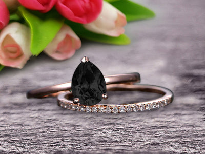 1.25 Carat Solitaire Pear Shape Black Diamond Moissanite Engagement Ring With Matching Wedding Band On 10k Rose Gold Bridal Ring Set Surprisingly