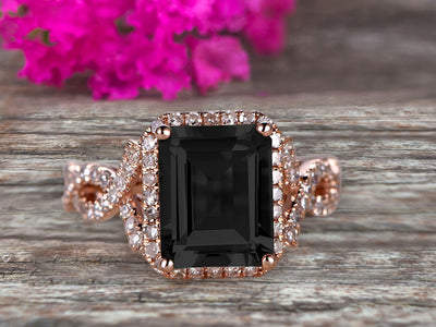 1.50 Carat Emerald Cut Pink Black Diamond Moissanite Engagement Ring 10k Rose Gold Promise Ring for Bride or Anniversary Gift Startling Jewelry Twisted Across Design Halo Art Deco