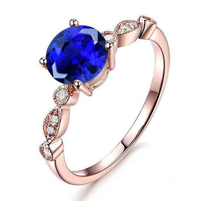 1.25 Carat Blue Sapphire and Moissanite Diamond Engagement Ring in 10k Rose Gold