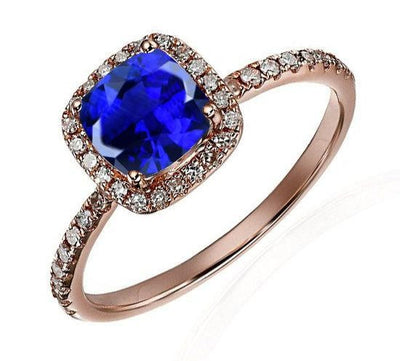 1.25 Carat Blue Sapphire and Moissanite Diamond Engagement Ring in 10k Rose Gold for Women