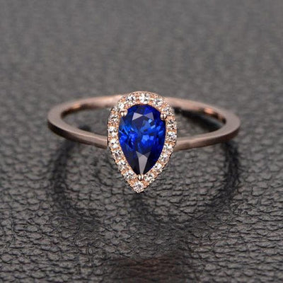 1.25 Carat Blue Sapphire and Moissanite Diamond Engagement Ring in 10k Rose Gold for her
