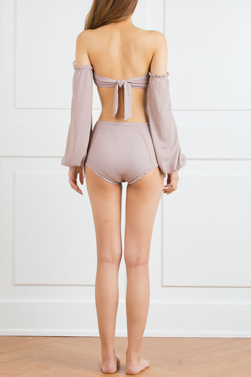 Lavender gathered top with dramatic bell sleeve and high-waisted bottom with bows