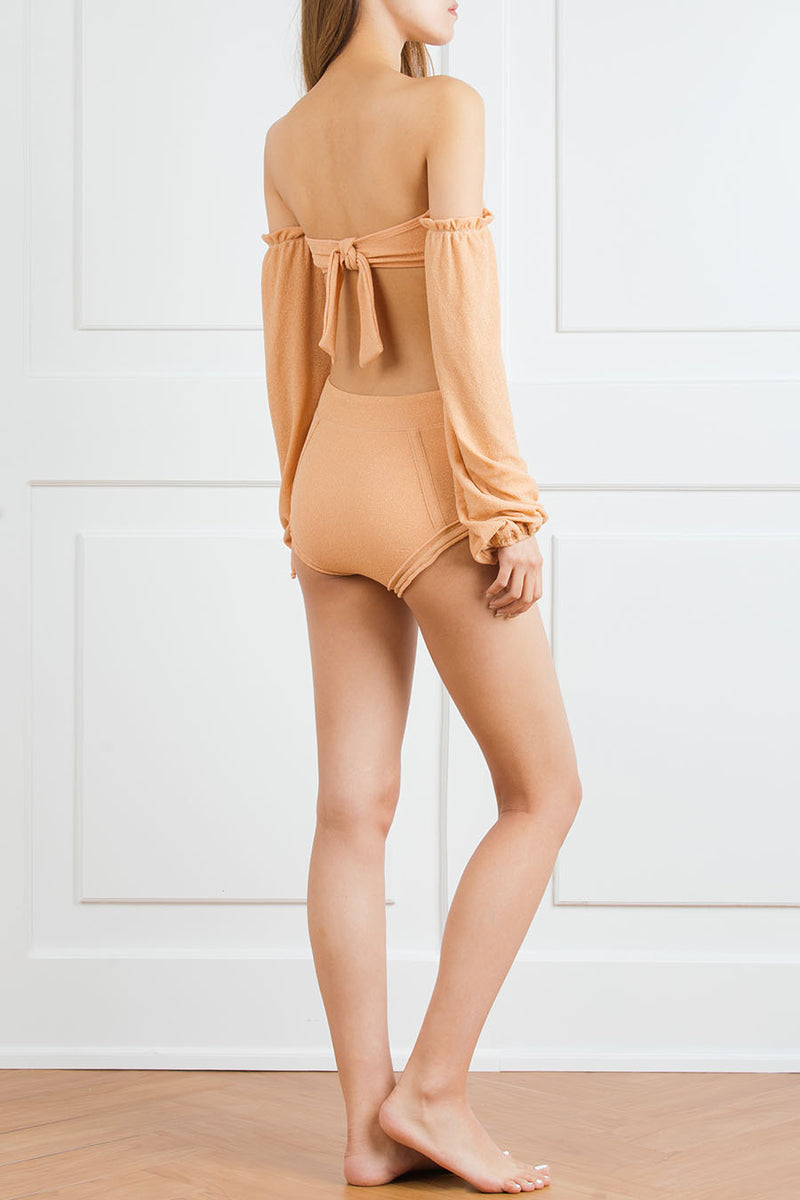 Peach gathered top with dramatic bell sleeve and high-waisted bottom with bows