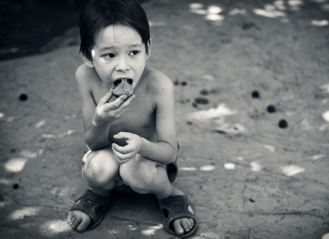 Child naked in the street