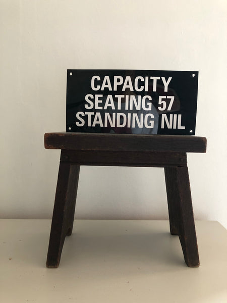 Vintage 'Seating Capacity' sign