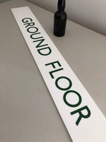Vintage sports 'Ground Floor' sign