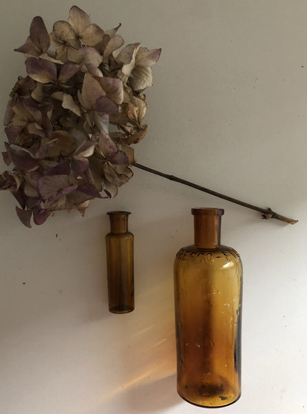 Pair of Vintage Amber glass Bottles