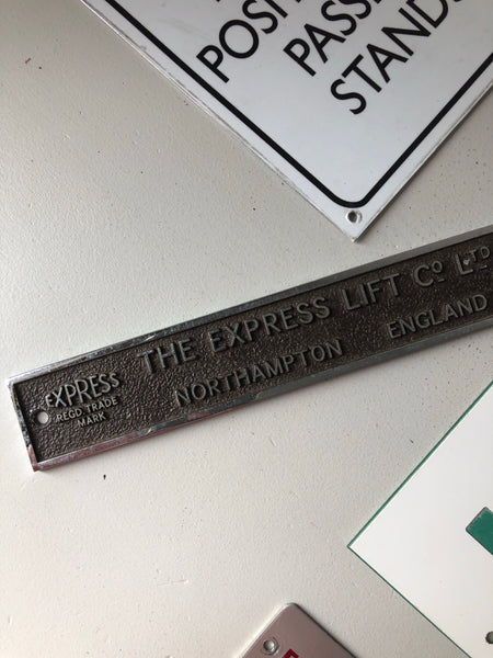 Heavy duty metal 'Express Lift' vintage plaque