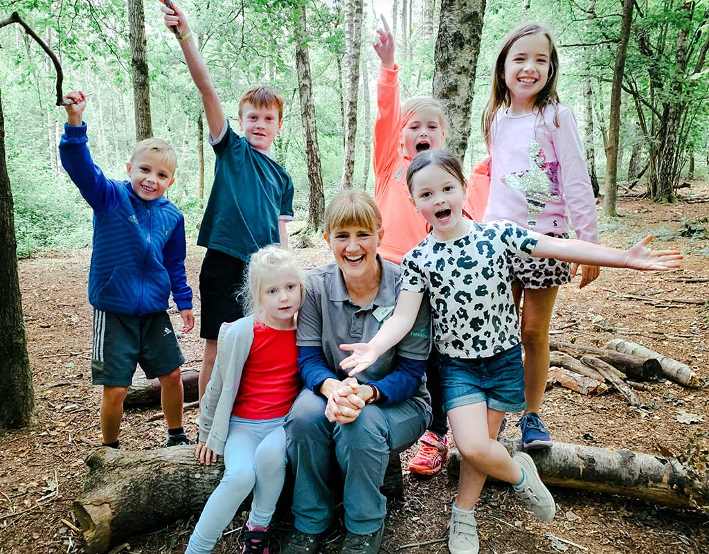 Group of young children at Blackwood Forest, Winchester with a Forest Holiday Ranger