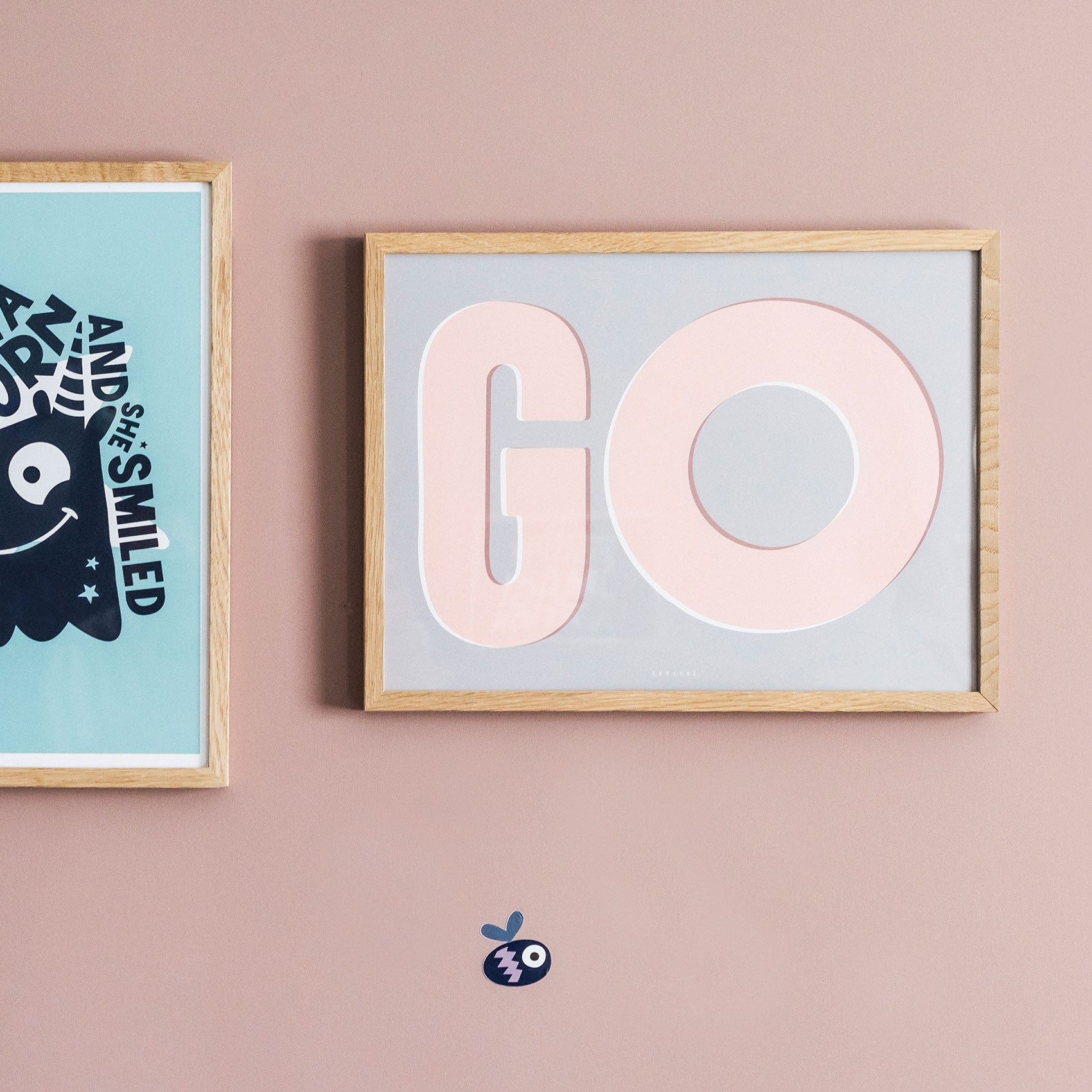 Framed 'Go explore' wall print in Grey, Peach and White mounted on a wall painted in Sulking room by Farrow and Ball