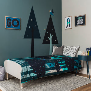 Treetop bedroom from Pea. Single Child's bed covered in Treetops bedding. Tree wall stencils and Wall poster prints decorate the two corner walls