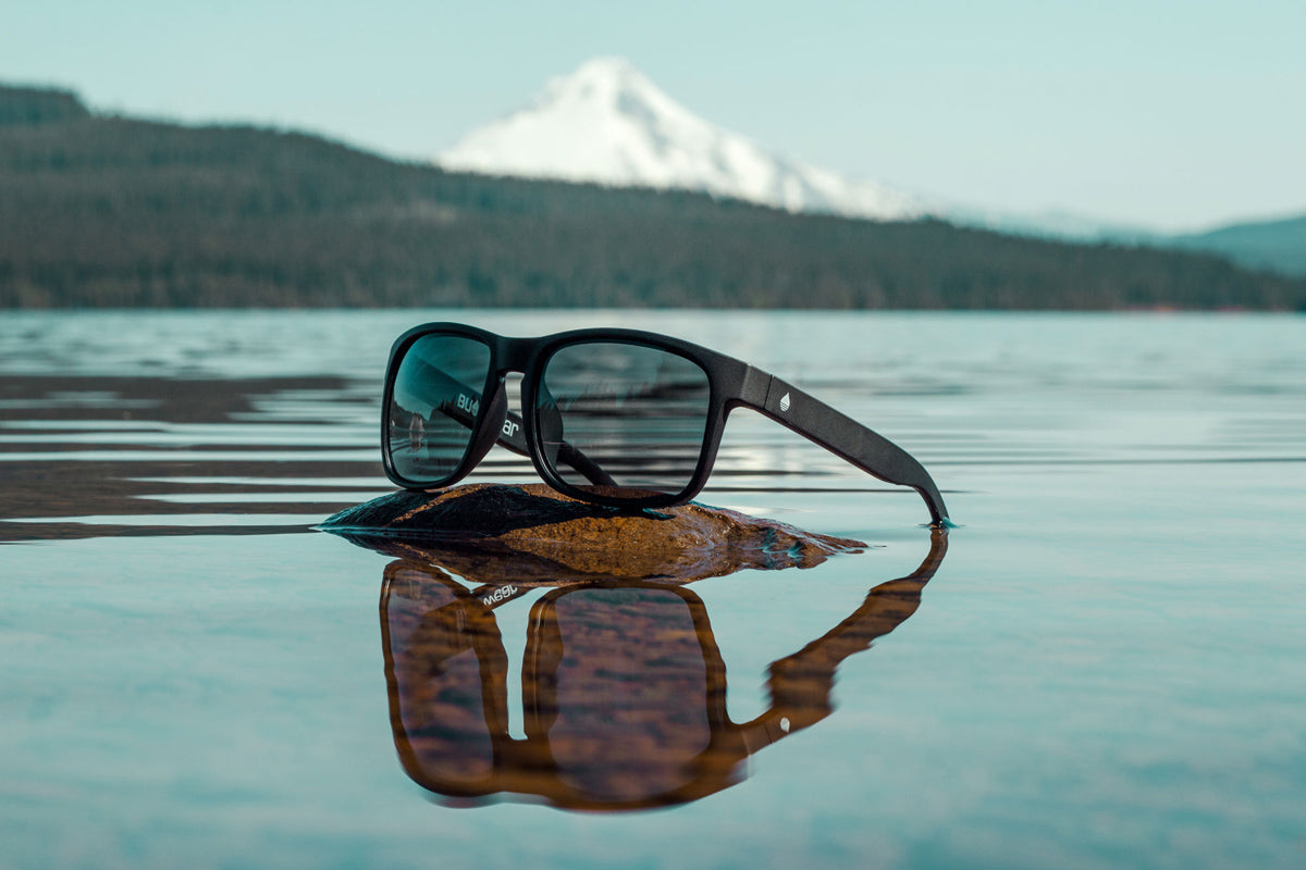 BUOY WEAR's black matte polarized floating sunglasses at the lake