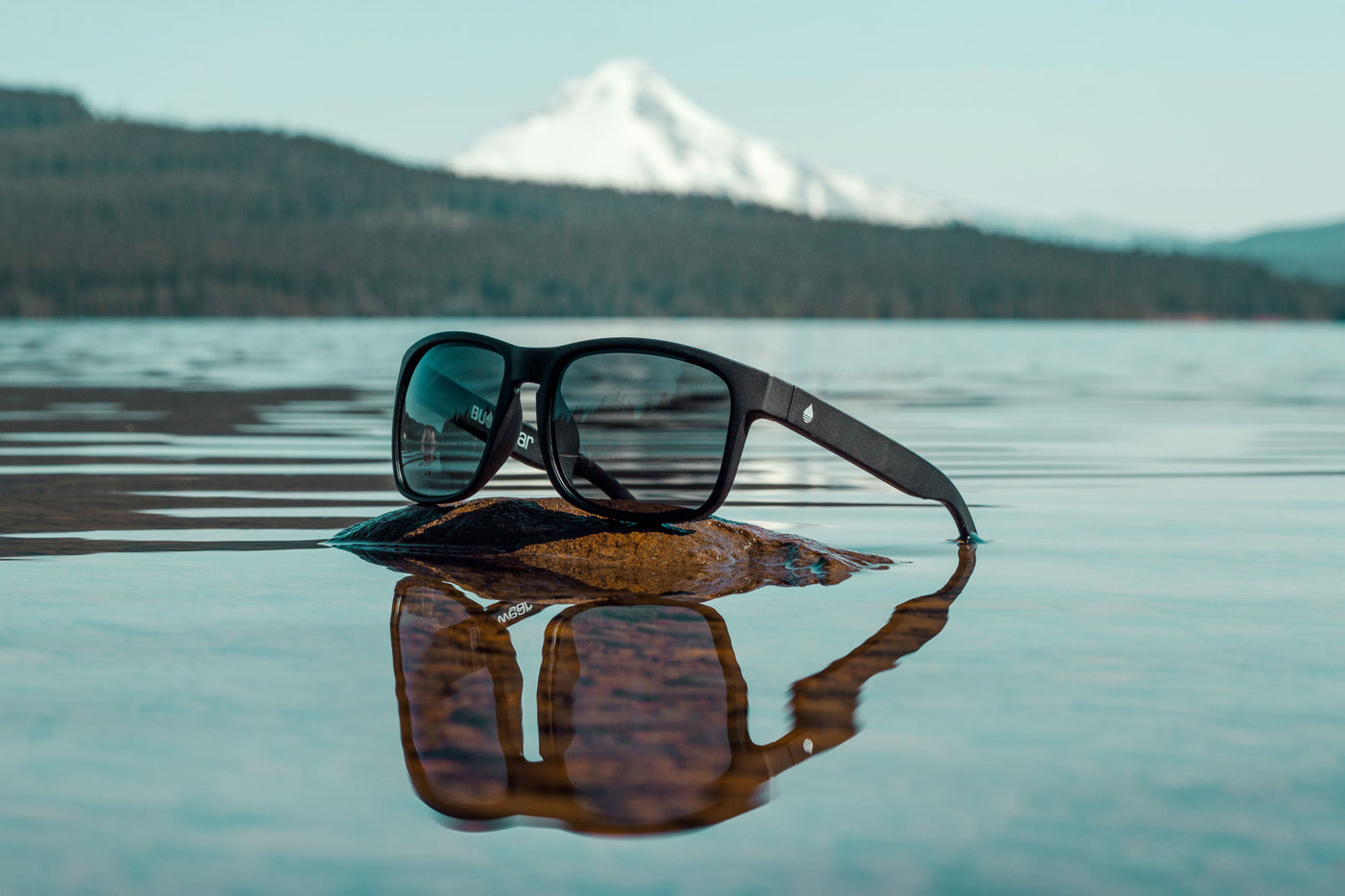 BUOY WEAR's Black Matte Polarized Floating Sunglasses on Timothy Lake, Oregon with Mount Hood in the background.