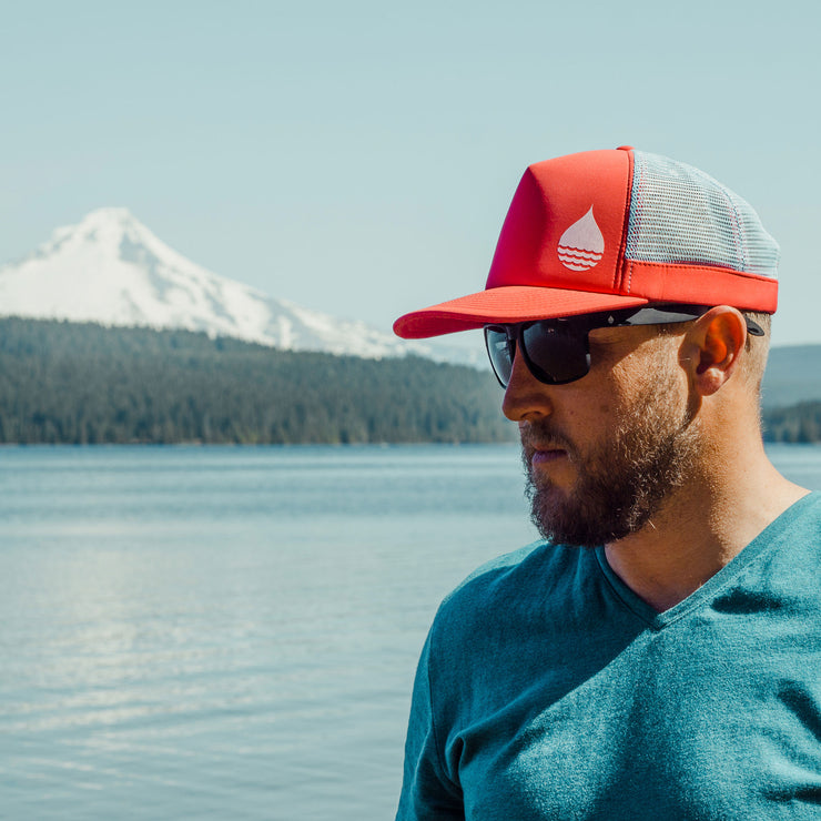 Black Matte Polarized Floating Sunglasses worn at Timothy Lake, Oregon with Mount Hood in the background - BUOY WEAR