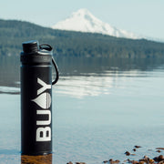 BUOY Brand Logo Transfer Sticker on a coffee mug at Timothy Lake, Oregon with Mount Hood in the background - BUOY WEAR
