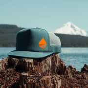 Dark Teal Limited Edition Floating, Waterproof Trucker Hat with Snapback at Timothy Lake, Oregon with Mount Hood in the background - BUOY WEAR