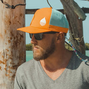BUOY founder John Ruffing wearing the Orange Floating, Waterproof Trucker Hat with Snapback in Mexico - BUOY WEAR