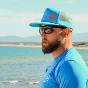 BUOY WEAR's ocean blue floating, waterproof trucker hat with snapback.