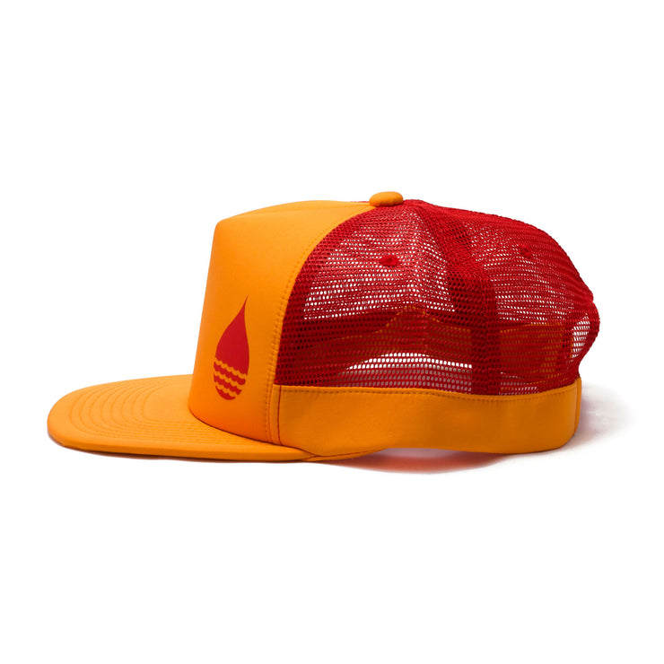 BUOY WEAR's tangerine floating, waterproof trucker hat with snapback, side.