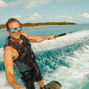 KZ Gear Floating, Polarized Sunglasses worn while on the water wakeboarding - BUOY WEAR