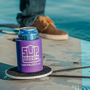 Zoomed in photo of a purple SUPBUDDY Koozie on a Stand Up Paddleboard in the water - BUOY WEAR