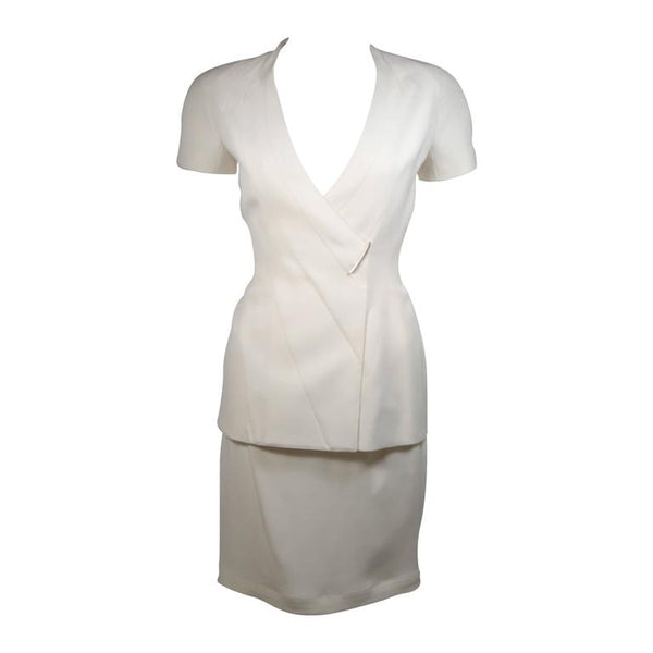 This Thierry Mugler skirt suit is composed of a white material. The jacket has a center front closures with silver hardware. The skirt has a classic pencil silhouette with zipper closure. In excellent vintage condition. Made in France.