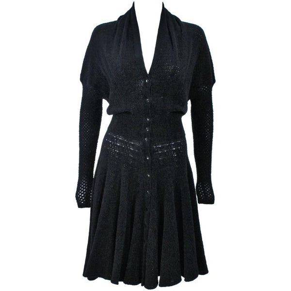 "ALAÏA Vintage Black Fuzzy Stretch Dress Size XS. This Alaia dress is composed of a black fuzzy stretch fabric (rayon/viscose blend). Features batwing style sleeves and center front buttons. In excellent vintage condition. **Please cross-reference measurements for personal accuracy. Measures (Approximately) Length: 44.5"" Bust: 38""-44"" Waist: 22""-25"" Hip: 38"""