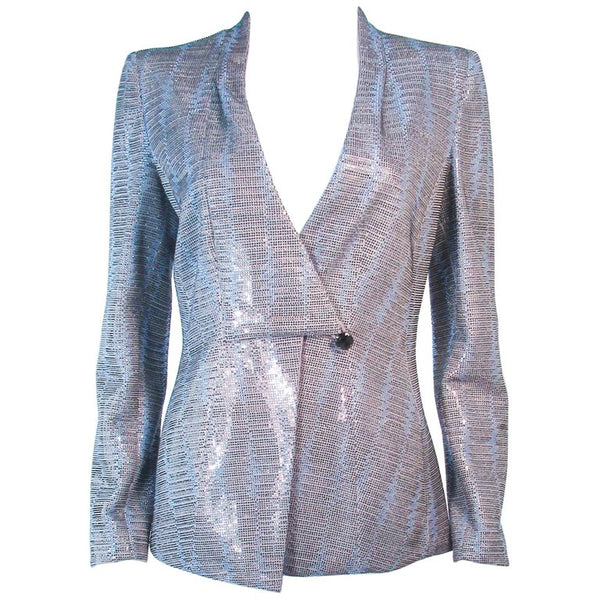 This Giorgio Armani is composed of a blue silk blend with rhinestone applique in different hues. Features center front snap button closures with neckline drape. In excellent pre-owned condition.