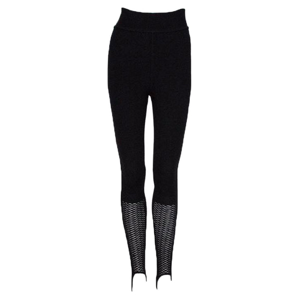 ALAÏA Circa 1990s RARE Black Knit Stirrup Leggings with Fishnet bottoms. Alaïa stirrup leggings. Black thick knit wool blend. Stretchy waistband. Pull-on style.