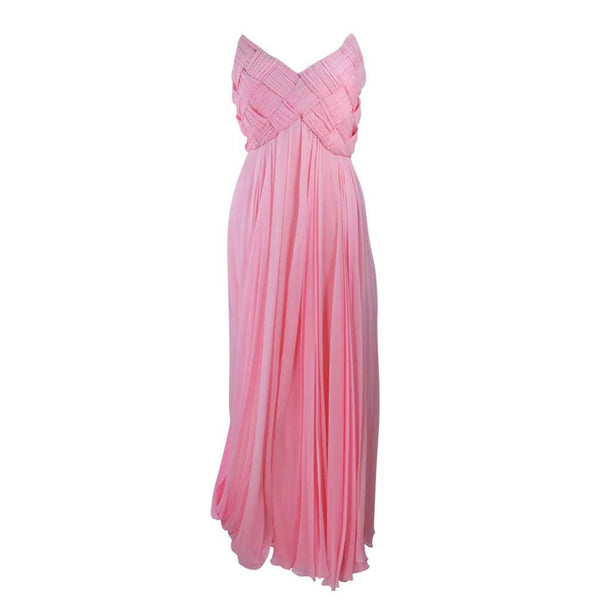 ARNOLD SCAASI Pink Draped Chiffon Gown with Criss-Cross Bodice Size 4-6. This Arnold Scaasi gown is composed of a pink chiffon. The bodice has a criss-cross design. The skirt features a drape style. There is a center back zipper closure with bow accent. In very good condition with some minor fading.