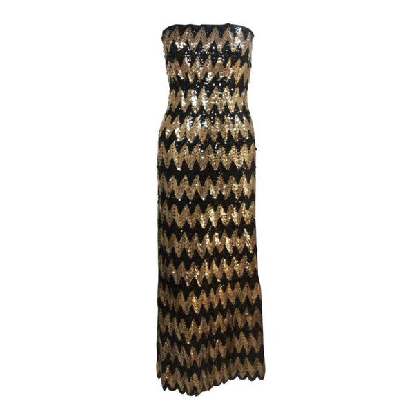 This Scaasi gown is composed of a sequined knit in black and gold hues with a zig zag pattern. There is a center back zipper and bustier foundation. In excellent great vintage condition.