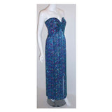 BOB MACKIE  Circa 1980 Strapless Beaded Gown. This is a long, multi colored, silk beaded gown by Bob Mackie, from 1980. The gown is strapless with beading all over, a constructed bustier, and a zipper up the back. This beaded gown by Bob Mackie is available to be viewed privately in our Beverly Hills boutique couture salon during business hours. Please telephone us with any questions or if you wish to set up a private appointment to view it personally. Please feel free to contact us anytime should you be lo