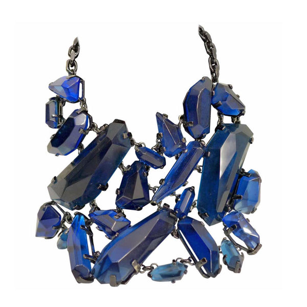 BURBERRY Large Blue Rhinestone Necklace. This Burberry statement necklace features large blue rhinestones and a metallic black chain with a clasp at the back. The clasp has an attached metallic black logo pendant.Measurements in Inches:Width: 7Height: 6 Chain: 19