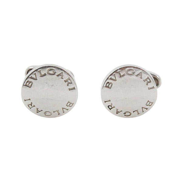 BVLGARI Circa 1990s Sterling Silver Cufflinks. Sterling Silver cufflinks Made by Bvlgari Curved circular shape Classic design featuring brand nameThey come with: ORIGINAL BOX NOT SHOWN IN IMAGES Italy, 1990s Measurements: Width: .5 in. Length: 1.25 in.