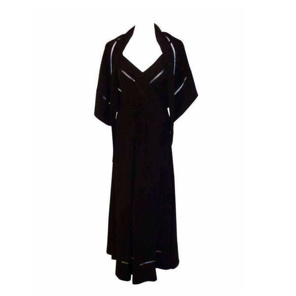 CHRISTIAN DIOR 1970S 2pc Black Gown w/ Shawl. This is a 2pc black gown with a matching shawl by Christian Dior Haute Couture, from the 1970's. The dress has thin straps, a tie bow around the waist, a v-neckline, and faggoting cut-out detail on the bust and hemline.Provenance Betsy Bloomingdale