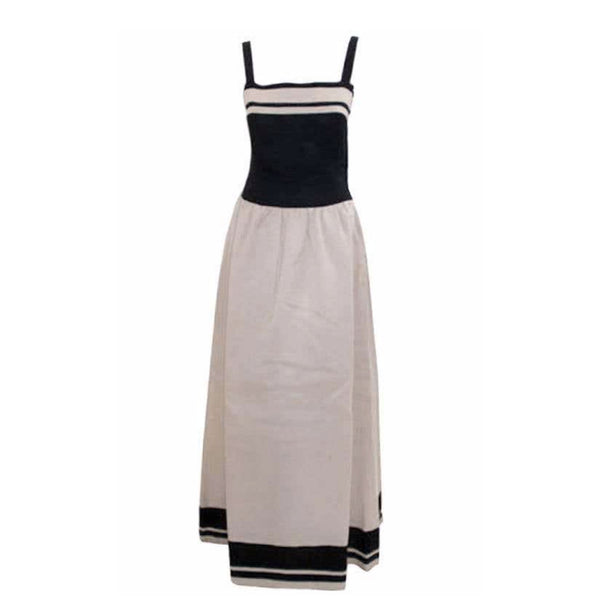 "This is a black and white long ""sailor"" style day dress by Christian Dior Haute Couture, from 1980. This dress has a full skirt with gathers at the hip, and a 16"" zipper on the side seam. Provenance: Betsy Bloomingdale"