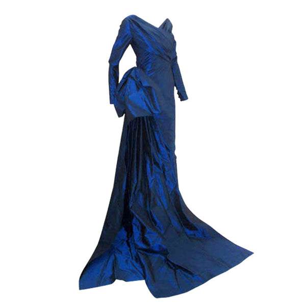 CHRISTIAN DIOR 1988 Long Blue Gown. This is a long royal blue silk taffeta gown by Christian Dior Haute Couture, from 1988-89. The gown has long sleeves, a wrapped front and back bodice, a large bow on the side hip, and two long trains