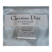 CHRISTIAN DIOR 1990s 2 pc Light Blue Skirt Suit This is a smart looking 2 piece skirt suit from Christian Dior. It is made of a light periwinkle blue wool with a matching silk lining. This suit has a fitted single button blazer with faux padded pockets, and a straight pencil skirt. Both jacket and skirt have fringed edges. Made in France