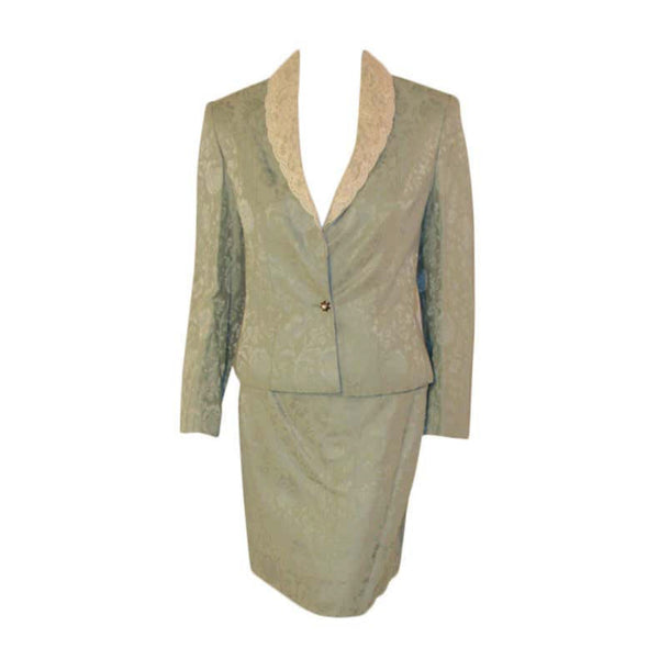 CHRISTIAN DIOR 1990s 2 pc Mint Green Skirt Suit with Lace Lapel Size 10. This is a charming 2 piece skirt suit from Christian Dior. The entire ensemble is made from a mint green colored viscose and lined blend floral jacquard fabric, with a cream colored silk lining.